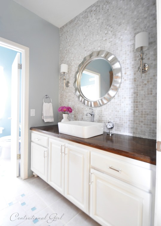 5 Ways to Upgrade a Bathroom on a Budget: 'After' picture of a newly painted cabinet