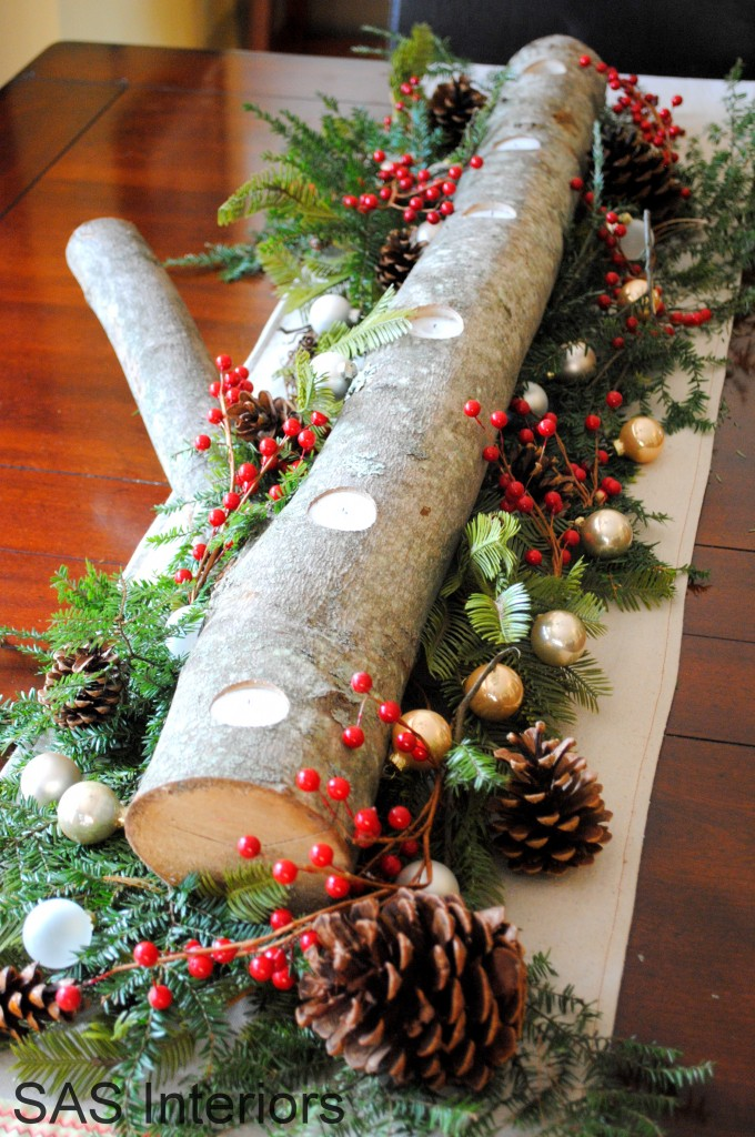 Log Centerpiece cradled in branches, pinecones, berries, and ornaments - a simple centerpiece arrangement for the holidays