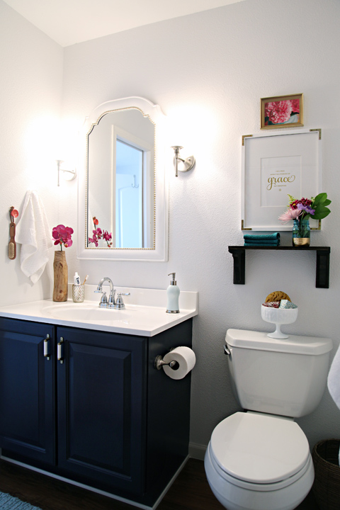 The layers of a space are the most important. In a bathroom, incorporate a pretty shower curtain, shelving, artwork, and anything that simply makes you happy.