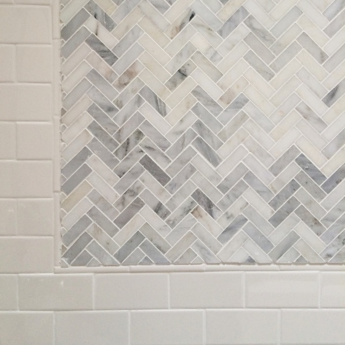 3 x 6 subway tile with herringbone accent tile in carrera
