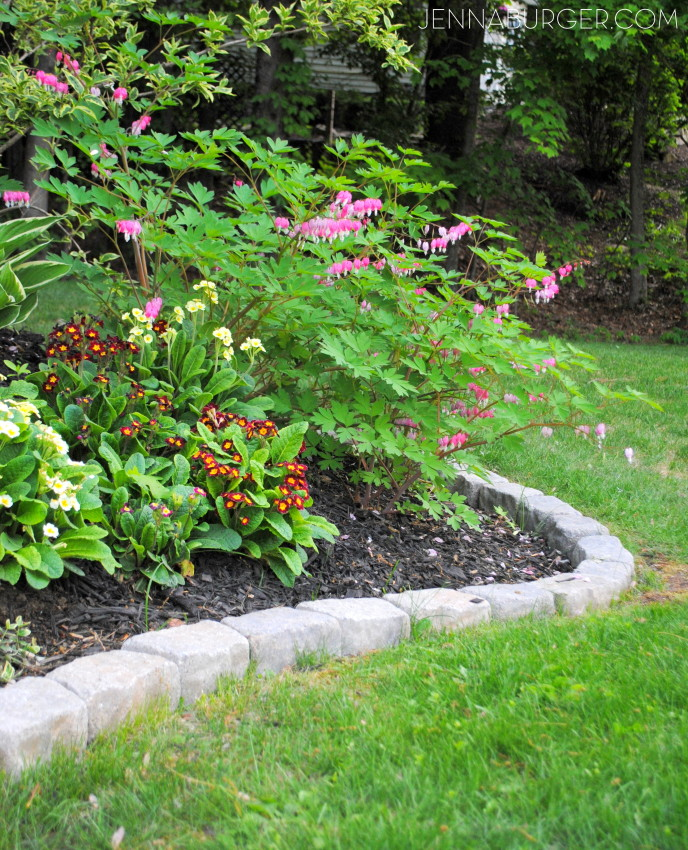 The Perfect Border for your Beds: Defining a gardens edge with inexpensive stone that fit any shape or size garden bed.  Details @ www.jennaburger.com