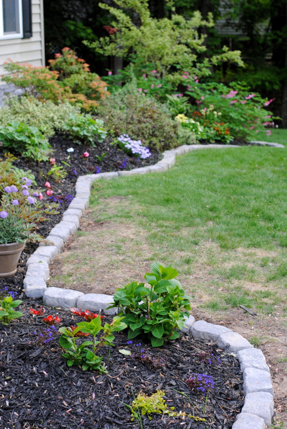 The perfect border for your beds jenna burger for Brick flower garden designs
