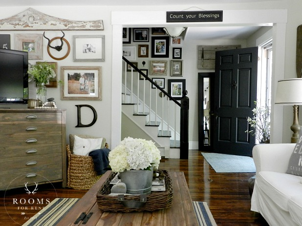 Relaxed with farmhouse flair!  The beautiful Entry + Gallery Wall designed by Bre of Rooms for Rent