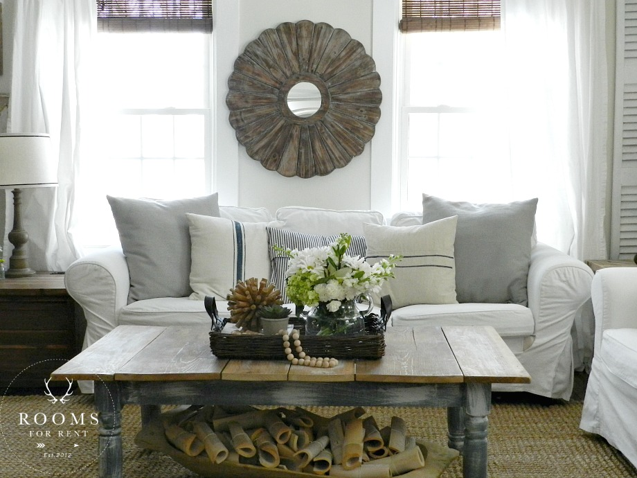 Relaxed with farmhouse flair!  The beautiful living room designed by Bre of Rooms for Rent