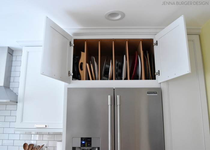 Full depth cabinet above the refrigerator with Vertical Dividers, perfect for trays, cookies sheets, and more!